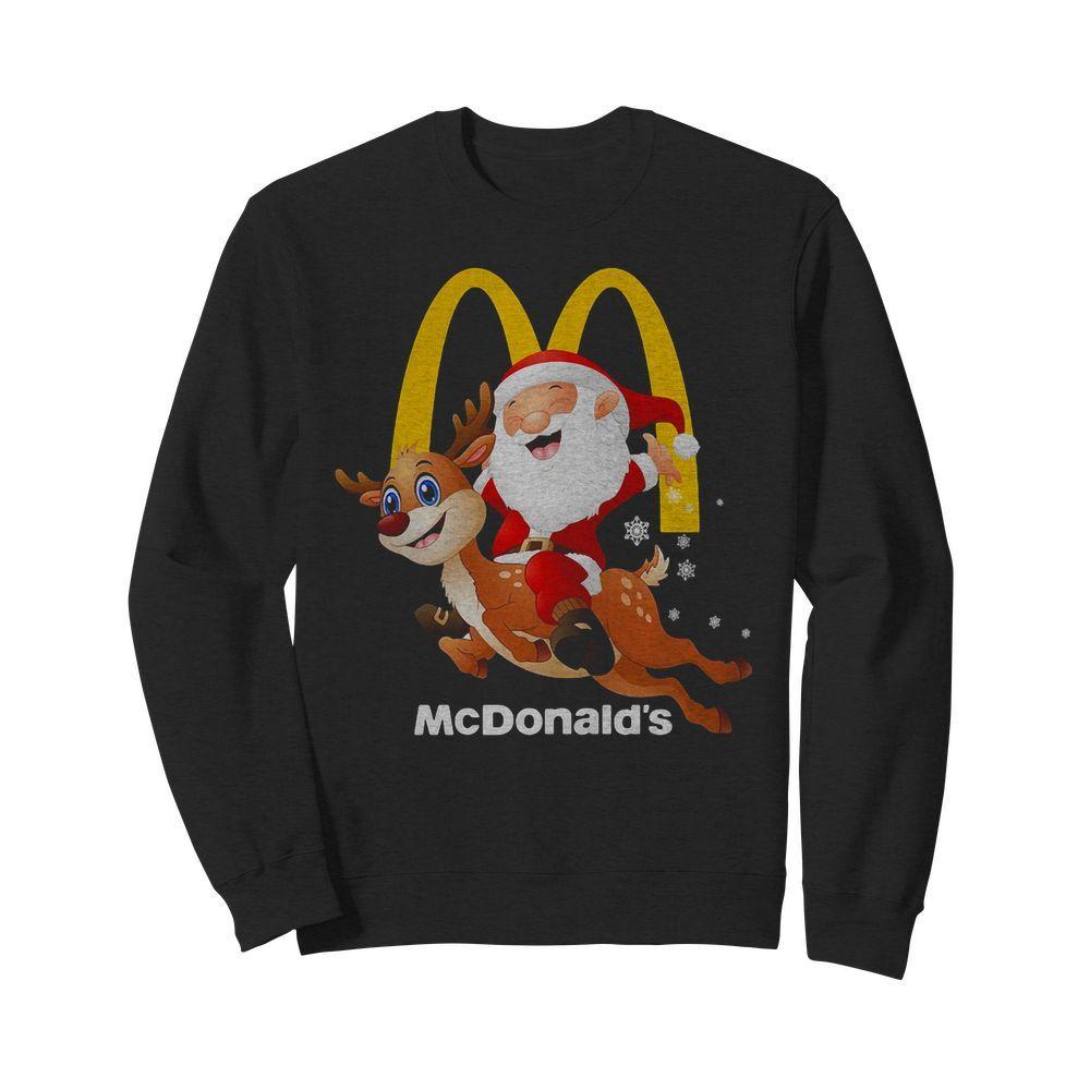 Santa Claus riding reindeer McDonald's Sweater