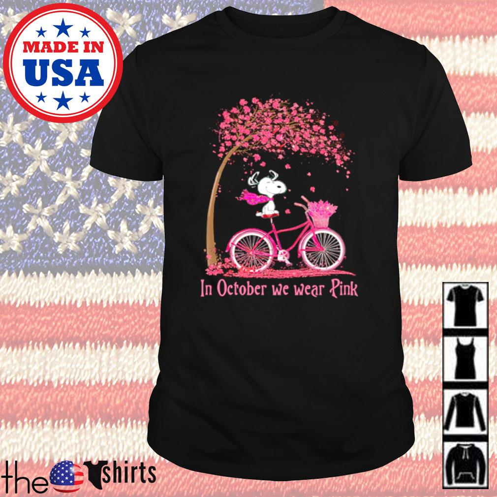 Snoopy sitting on bicycle pink In October we wear pink shirt